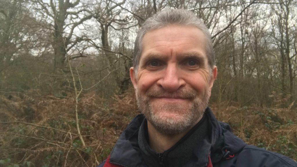 Mark Landon, Trustee, outside in the woods