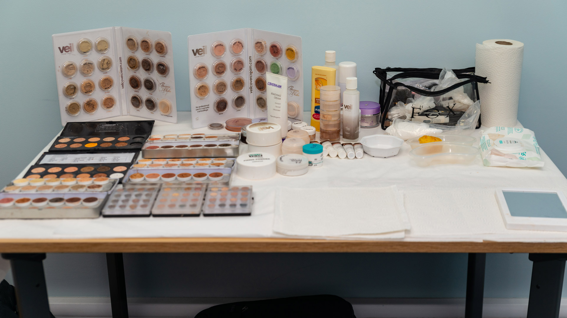 Skin camouflage products laid out on a table