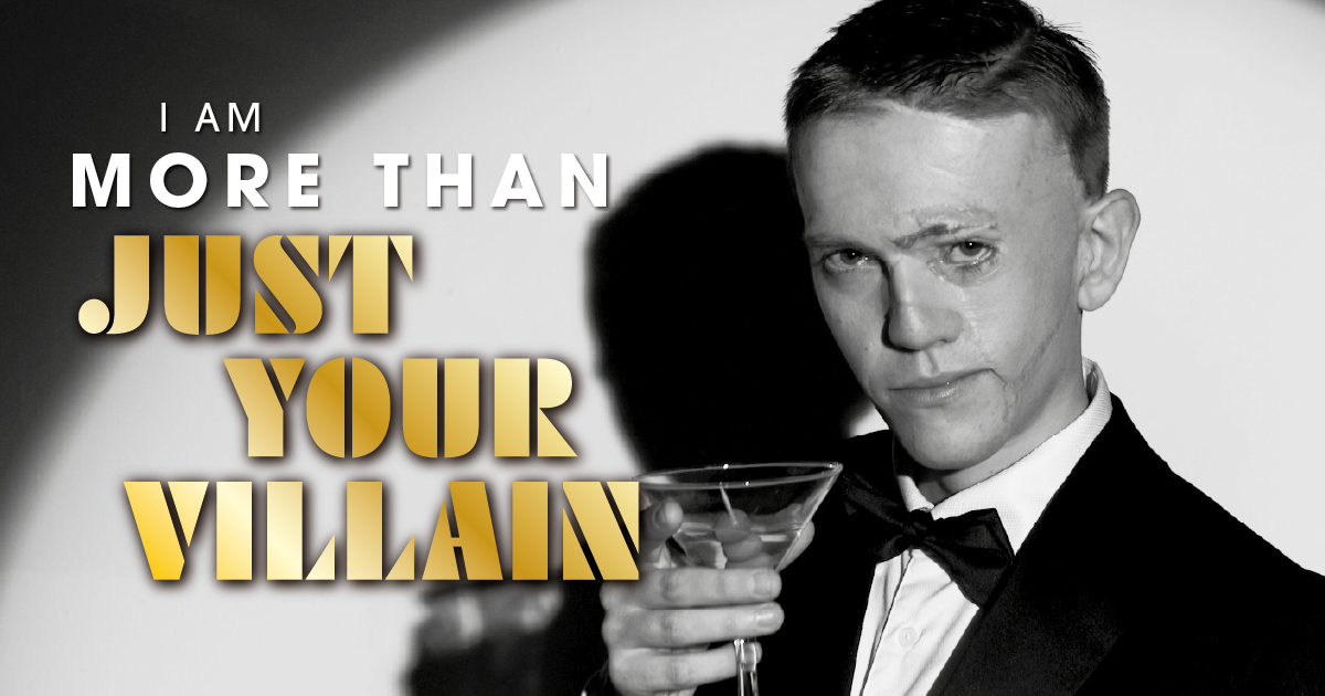 """A person with a visible difference dressed as James Bond, with the test """"I am more than just your villain"""""""
